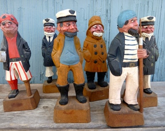 Group of six wood carved sailors, pirates, sea captains, fisherman, folk art souvenirs, beach cottage style