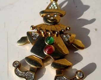 Articulated clown pendant - gold tone with diamante, green and red cabochons