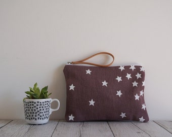 Handprinted fabric clutch with white stars on mauve color fabric
