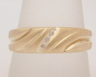 Man's 10K Yellow Gold Wedding Band With Diamond Accent