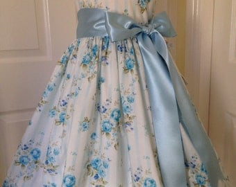 Stunning girls party dress, vintage style blue floral with satin ribbon sash, age 5 to 6.