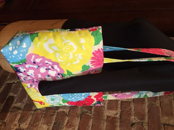 Tote bag with pockets.  Beautiful, large, colorful, roomy tote with button and loop closure.  Great for beach!
