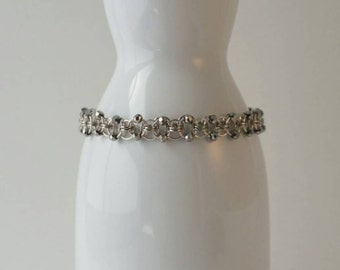 Beaded gunmetal chainmaille bracelet, helm weave, decorated with silver-gray beads