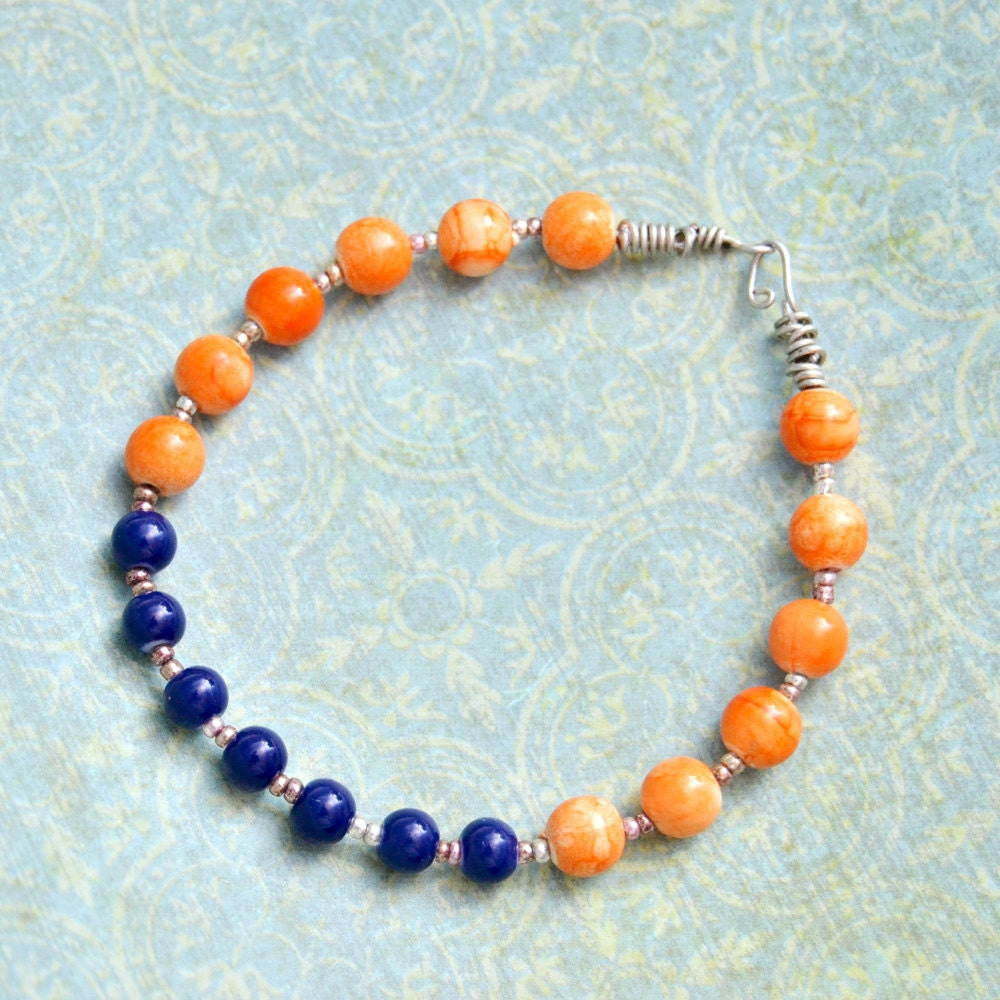 orange and blue bead bracelet with metal and handmade
