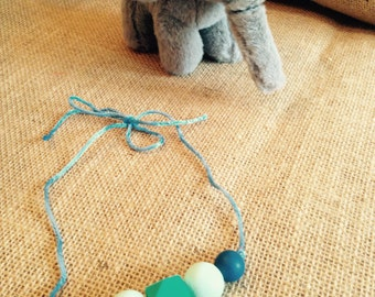 BITE Teething Jewelry made with silicone beads. Perfect for moms and her little ones