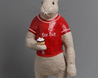 Rabbit paper mache in a red t-shirt with her chocolate cake