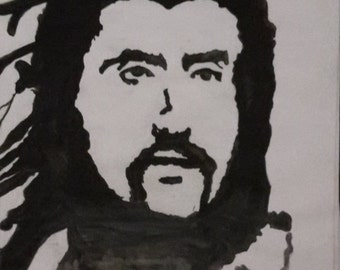 Black and white contrast portrait of Baris Manco