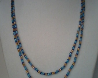 Double-strand beaded necklace, blue/gold