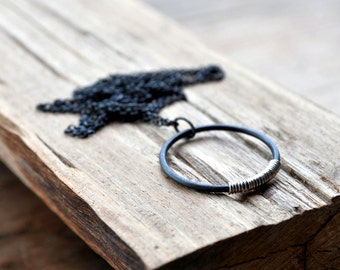 Silver Lining Necklace - Oxidised Sterling Silver, with a Handmade Circle Featuring a Splash of Contrasting Silver Coil.