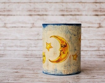 Whimsical decoupage pencil holder with suns, moons and stars