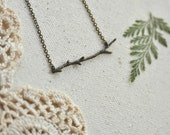 through the woods. a dainty tree branch necklace