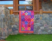 Sunset Serenade Quilt -- Kaffe Fassett Collective Fabrics used to capture the colors of a beautiful sunset in this show stopping quilt.