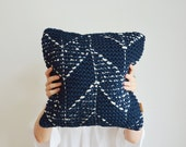 hand knitted pillow cover made of lambswool, graphic embroidery, woven reverse in gray
