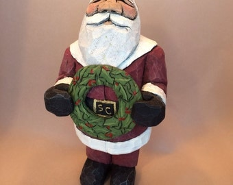 Hand Carved Wood Santa with Carved Wreath