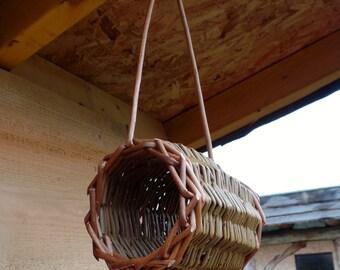 Hanging cylinder bird feeder