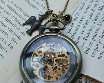 TUMBLEWEED – Mechanical working pocket watch pendant suspended from a brass oxidized faceted ball chain.