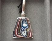 Fordite, medium sized pendant