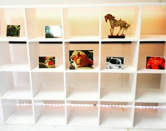 Custom bookcase, shelving unit console for storage entertainment shoestorage,  video games, and all things or great displaying memorabilia !