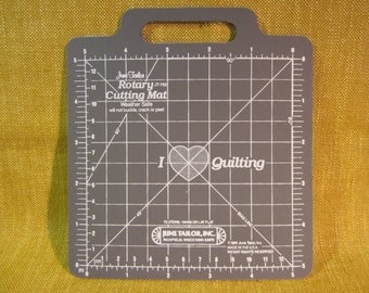 "June Tailor mini rotary cutting mat 5"", 1/8"" increments, superior durability,gridded,non skid,textured,handle,quilting, made in USA"