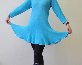 Turquoise linen tunic dress with three-quarter length sleeves and scalloped hem.