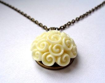 Bronze, bronze tone pendant necklace ornate resin cabochon creme white