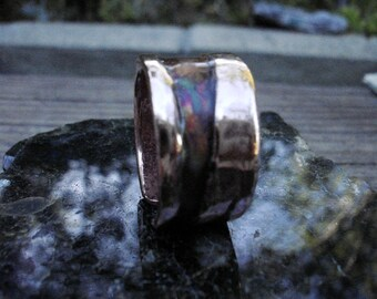 Burnt Ring with Hard Torch. Heat Matt Patinaed with epoxy cover.    1.7mm thick and 13mm wide.