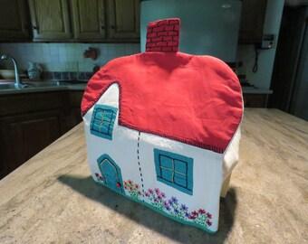 Homespun embroidered and applique tea cozy