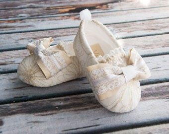 gold and white baby shoes for baptism christening
