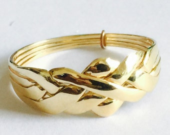 9k solid gold 4 band puzzle ring