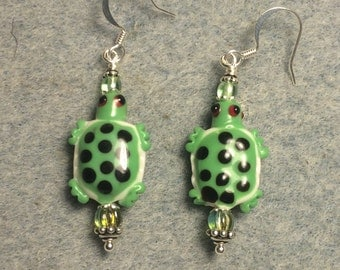Green and white spotted lampwork turtle bead earrings adorned with green Czech glass beads.