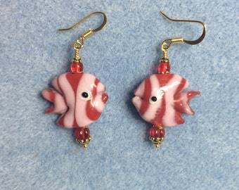 Red and pink lampwork angelfish bead earrings adorned with red Czech glass beads.