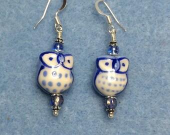 Light blue ceramic owl bead dangle earrings adorned with light blue Czech glass beads.
