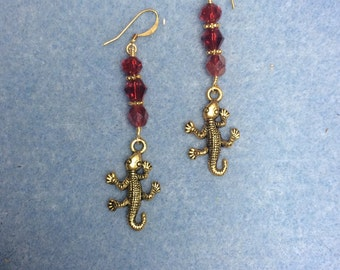 Gold lizard charm dangle earrings adorned with bright red Czech glass beads and crystal beads.