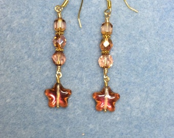 Sparkly orange pink Czech glass star dangle earrings adorned with rose pink Czech glass beads.