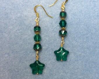 Teal green Czech glass star dangle earrings adorned with teal Czech glass beads.