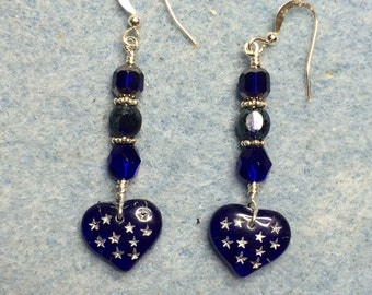 Dark blue glass heart dangle earrings adorned with blue Czech glass beads.