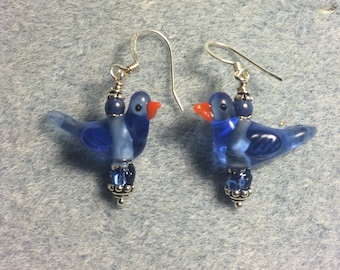 Bright blue lampwork songbird earrings adorned with bright blue Czech glass beads.