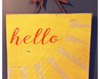 """Wooden """"Hello"""" sign"""