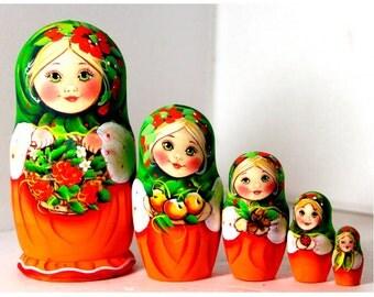 Nesting doll matryoshka Russian girl with a basket of rowan green red - kod48k
