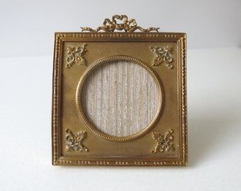 ANTIQUE BRASS FRAME - Neoclassical square French easel frame from the late 1800's