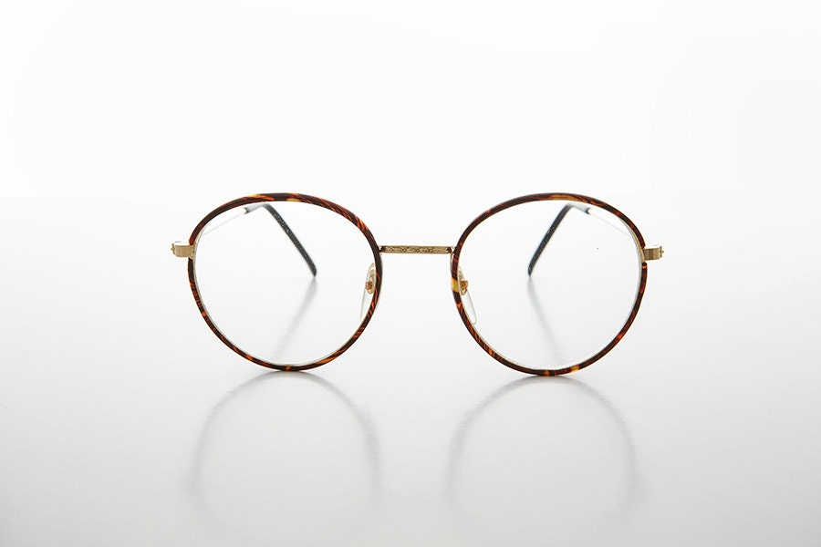 round preppy polo style clear lens glasses with gold tortoise wrapped frame einstein
