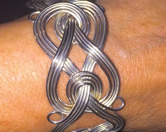 Silver Cuff Braclet designed in multiple strands of Silver delicately Twisted and Swirled into Elegant Design