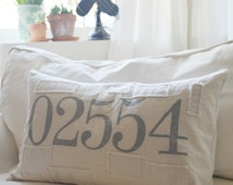 custom number pillow with multiple numbers. available in 20x20, 16x26, 16x24