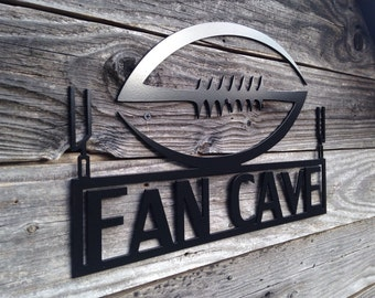Fan Cave Metal Sign