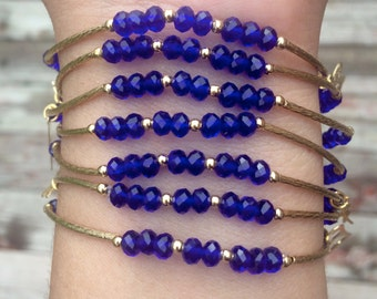 Crystal Royal Blue set of bracelets with gold plated charms - Semanario de piedritas azul rey con dijes de chapa de oro
