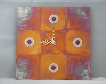 Inside the box - is a hand torched copper wall clock with abalone hour markers.