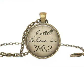I Still Believe in 398.2.  Fairy Tales. Gift. Librarian. Comes as a necklace or keychain.