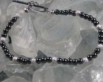 Hematite bracelet with heart toggle clasp and single Moonstone