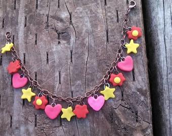 Star, heart, and flower charm bracelet