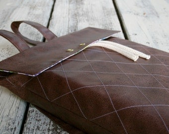 Brown leather rucksack with light blue Plaid